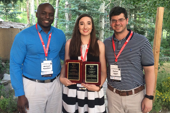 Michael Hamilton, Emily Wall and Parker Jones display a few of the awards their team won at the recent ASEE conference