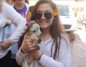 Biological engineering major Karlee Mott with a baby goat